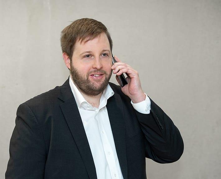 Fotografie Telefonat Kluge Versicherung